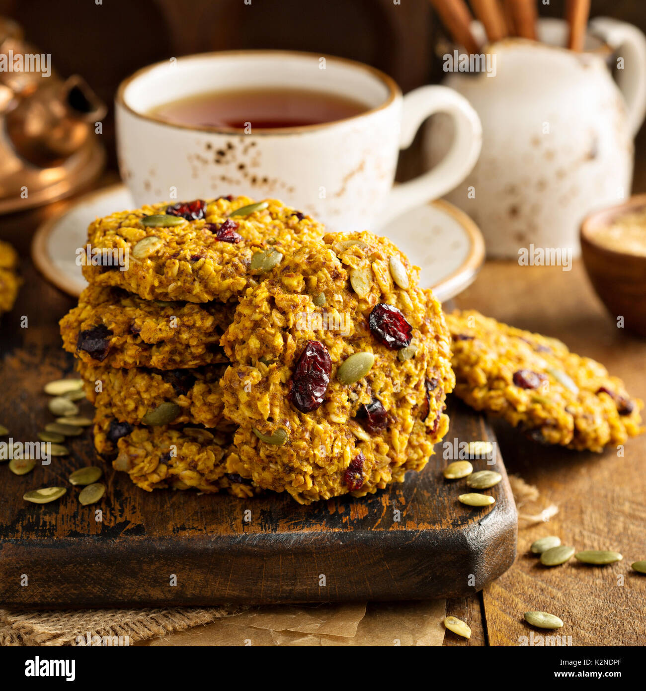 Breakfast oatmeal cookies with pumpkin puree, cranberry and seeds Stock Photo
