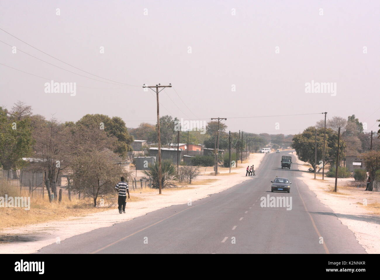 The main road into the town of Maun in Northern Botswana, on the edge of the Okavango Delta - Stock Image