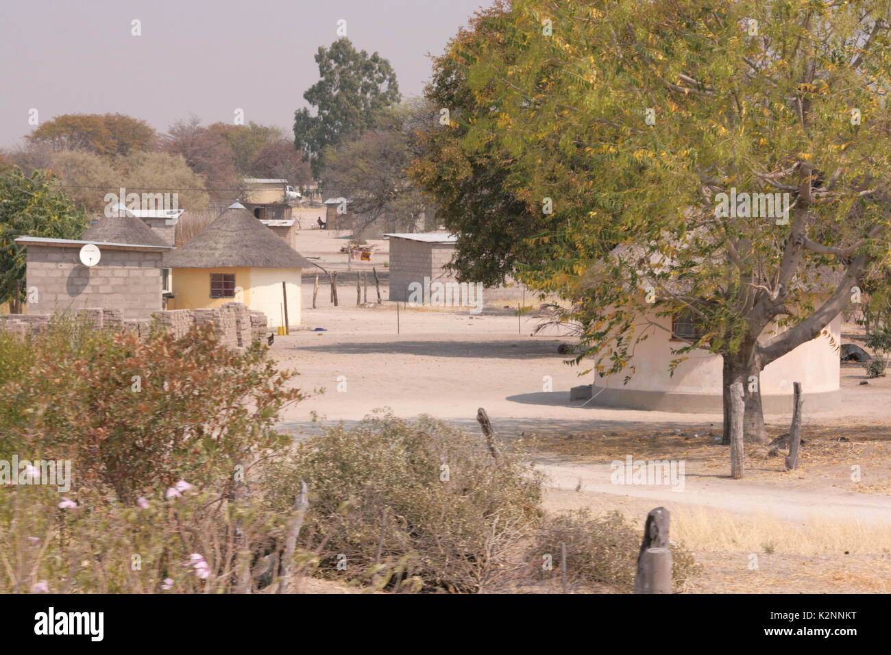 Houses and huts in the city of Maun, on the edge of the Okavango Delta, Botswana - Stock Image