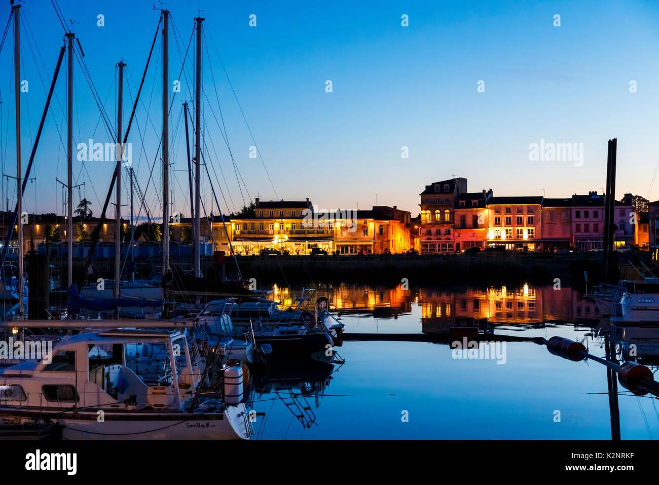 Pauillac marina at night, yachts, reflections and illuminated buildings, Gironde Estuary, Gironde department in Stock Photo