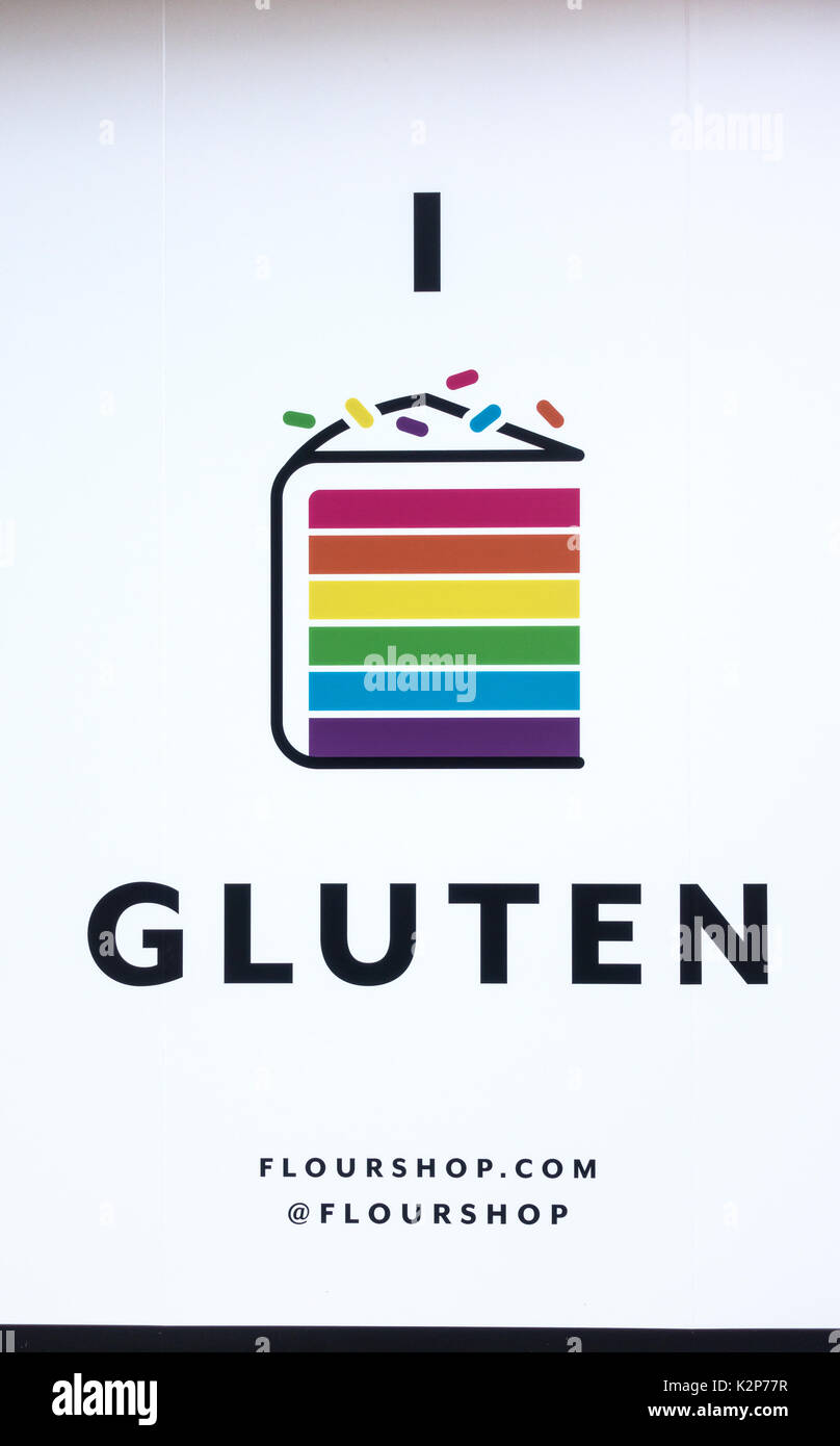 Advertising poster in a shop window shows one word: gluten. Is it pro or con? - Stock Image