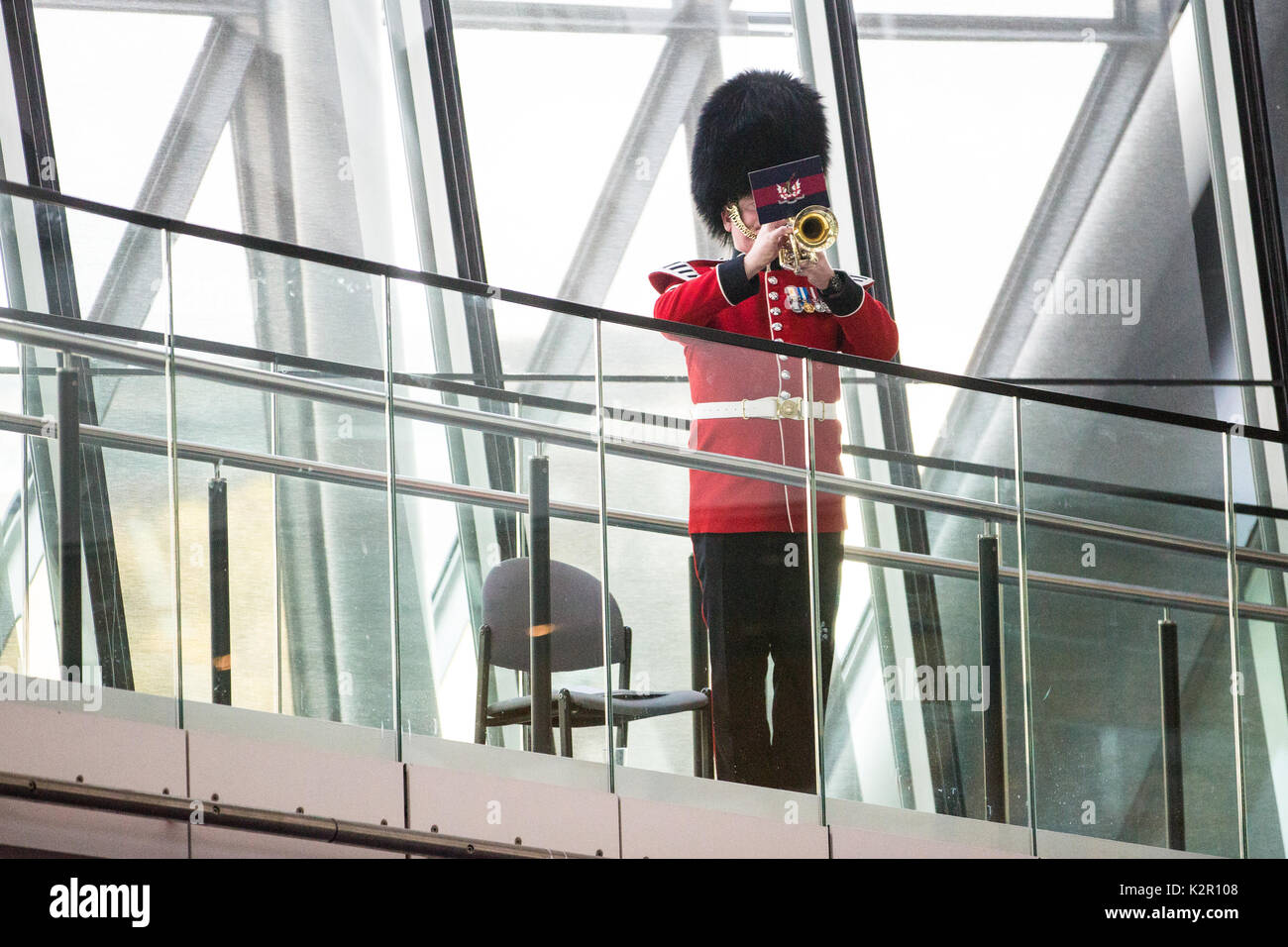 London, UK. 10th Nov, 2017. A bugler plays the Last Post at the Annual Service of Remembrance at City Hall, attended by Mayor of London Sadiq Khan, Jennette Arnold OBE AM, Chair of the London Assembly, Members of Parliament, London Assembly Members, Greater London Authority staff, representatives from London Government and public service organisations, and members of the Armed Forces, to commemorate those who served and lost their lives in the two world wars and other conflicts. Credit: Mark Kerrison/Alamy Live News - Stock Image