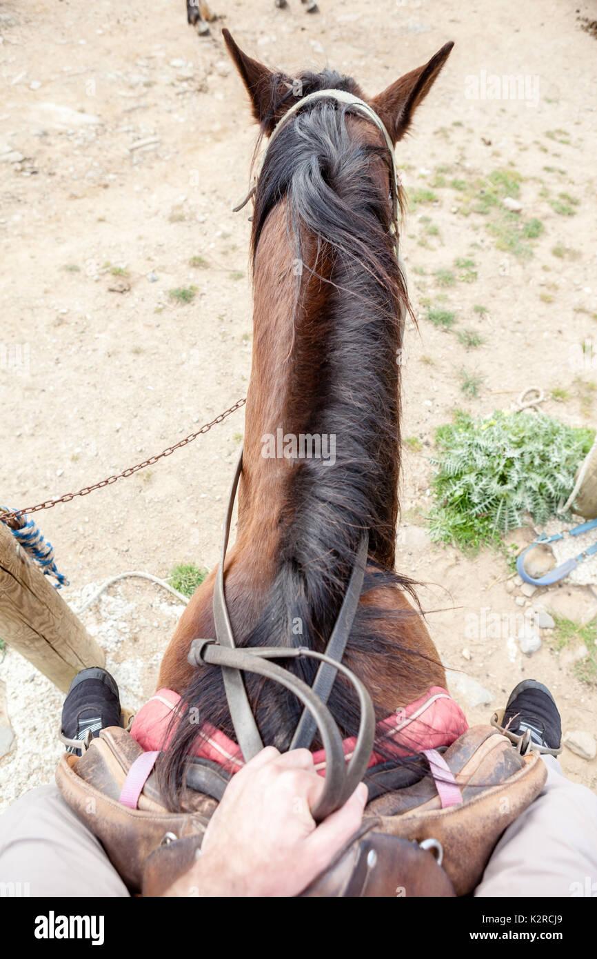 Riding a horse in Menorca - Stock Image