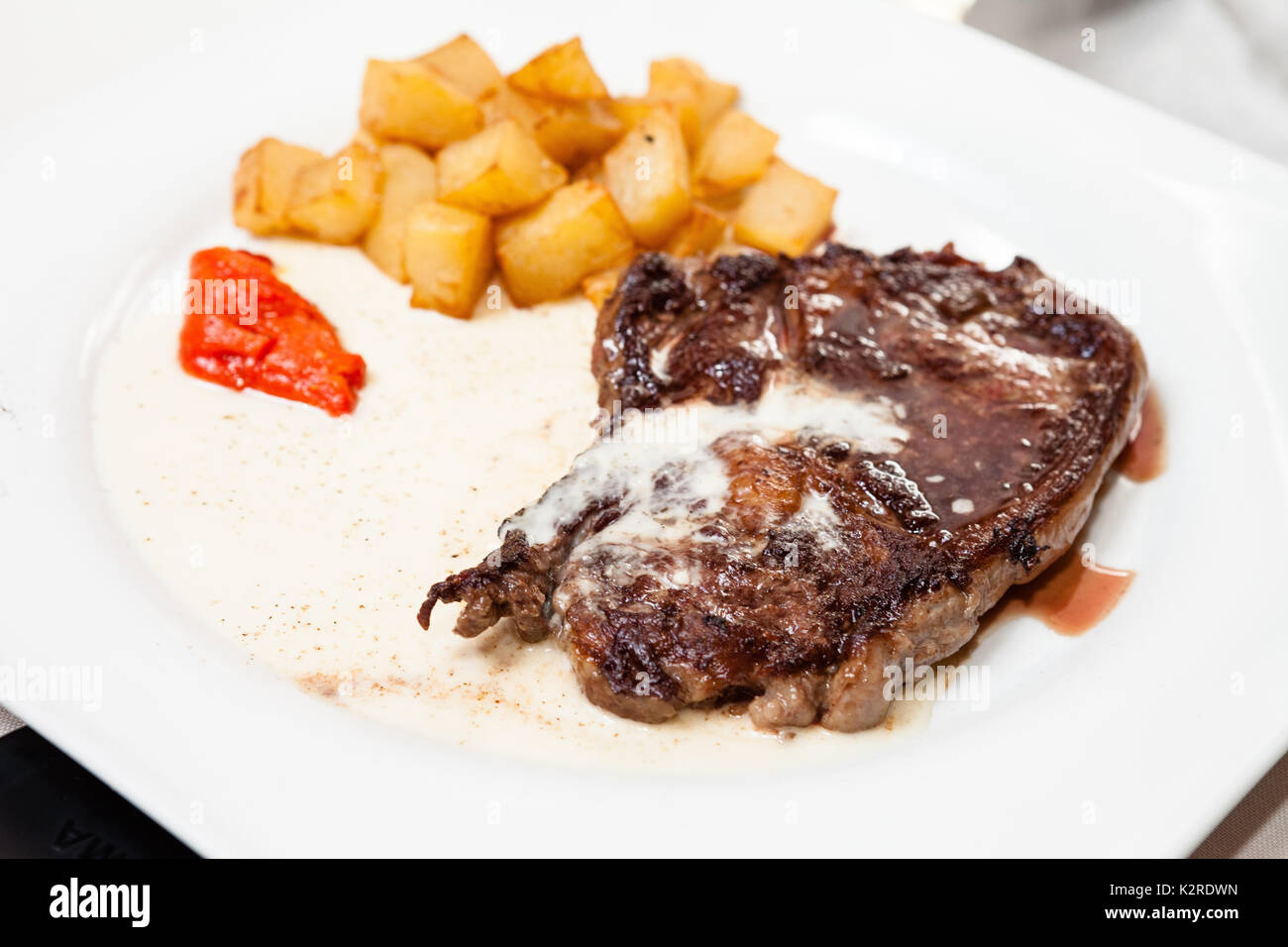 Steak with potatoes - Stock Image