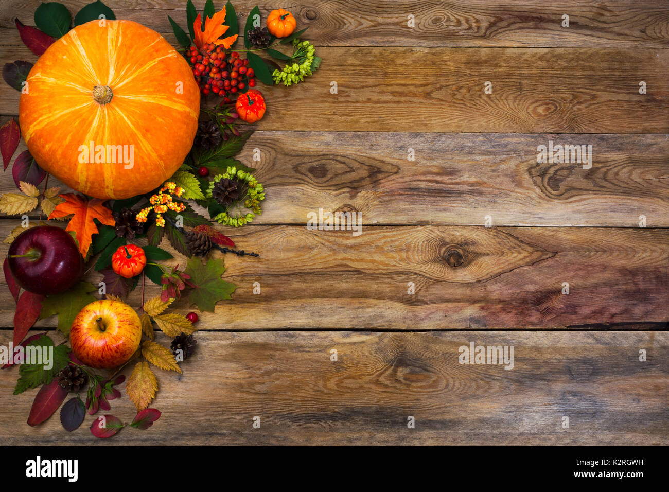 Happy Thanksgiving Decor With Pumpkin Apples And Autumn Leaves On The Left Side Of Rustic Wooden Table Fall Background Seasonal Vegetables
