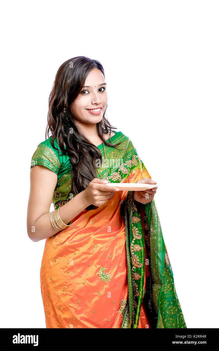 2516672f93 Happy young beautiful traditional Indian woman in traditional saree - Stock  Image