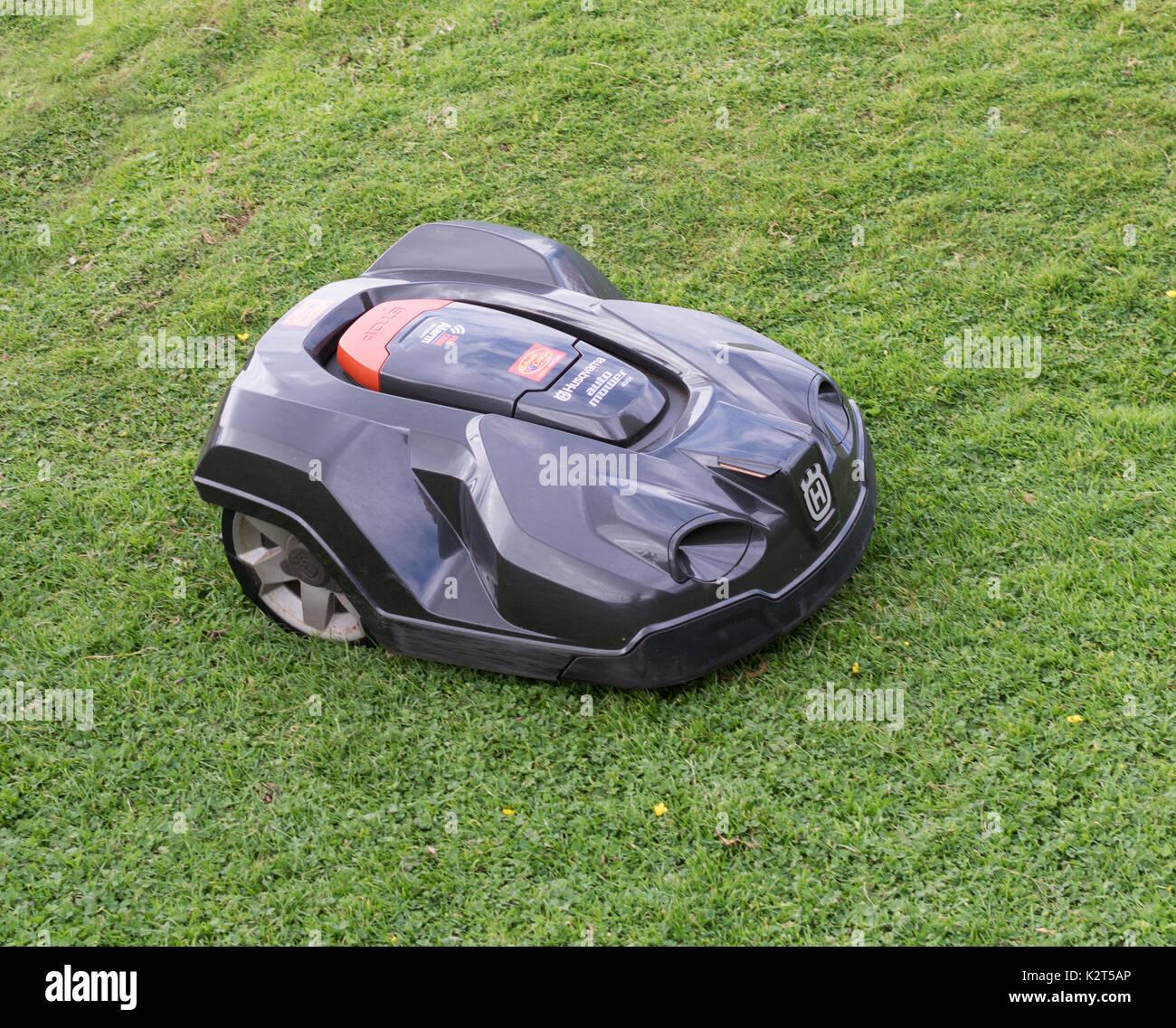 Husqvarna Automower, or robot mower, cutting grass Stock Photo