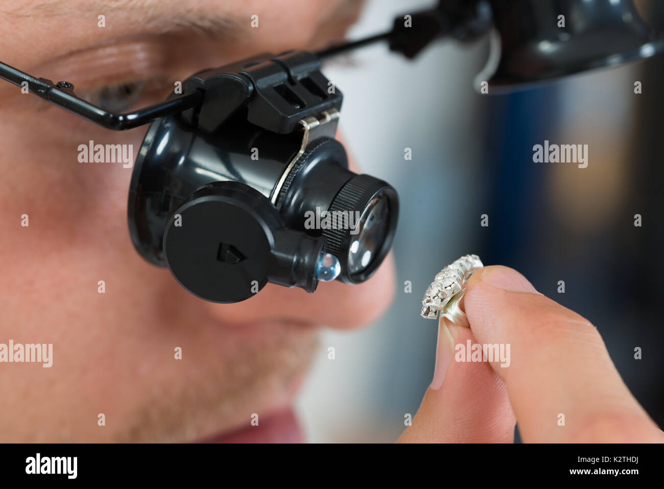 Close-up Of Jeweler Looking Ring Through Magnifying Loupe - Stock Image