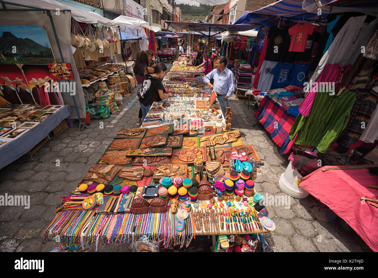 April 29, 2017 Otavalo, Ecuador: indigenous quechua people selling artisan gifts on stands set up on the street Stock Photo