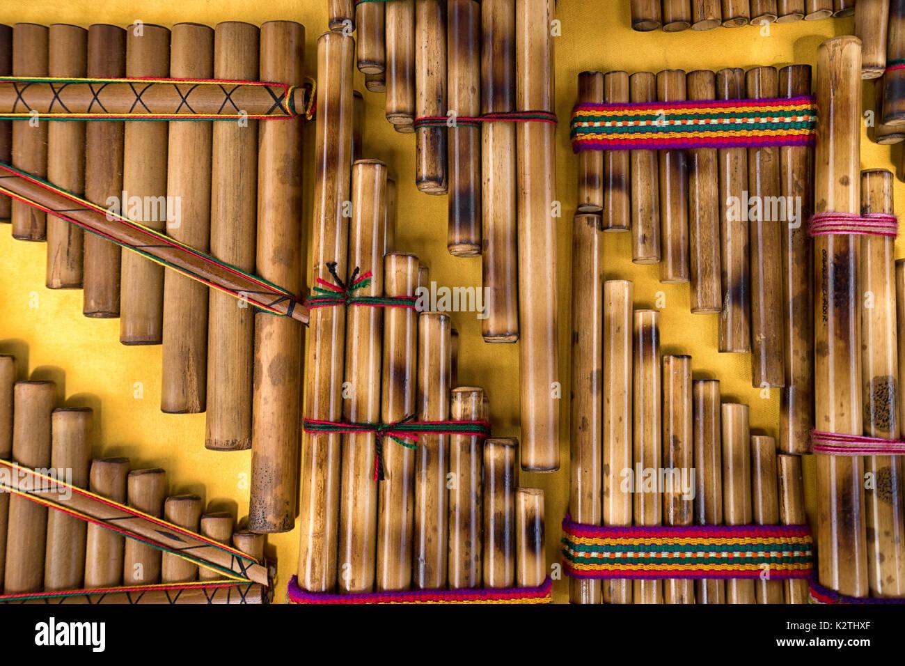 pan flute closeup in the indigenous artisan market in Otavalo Ecuador - Stock Image