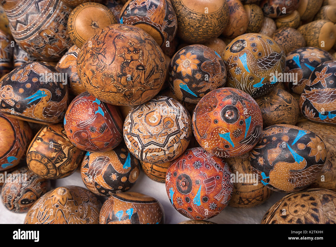 April 29, 2017 Otavalo, Ecuador: indigenous quechua crafts made of coconut shell  selling on the street in the Saturday market - Stock Image
