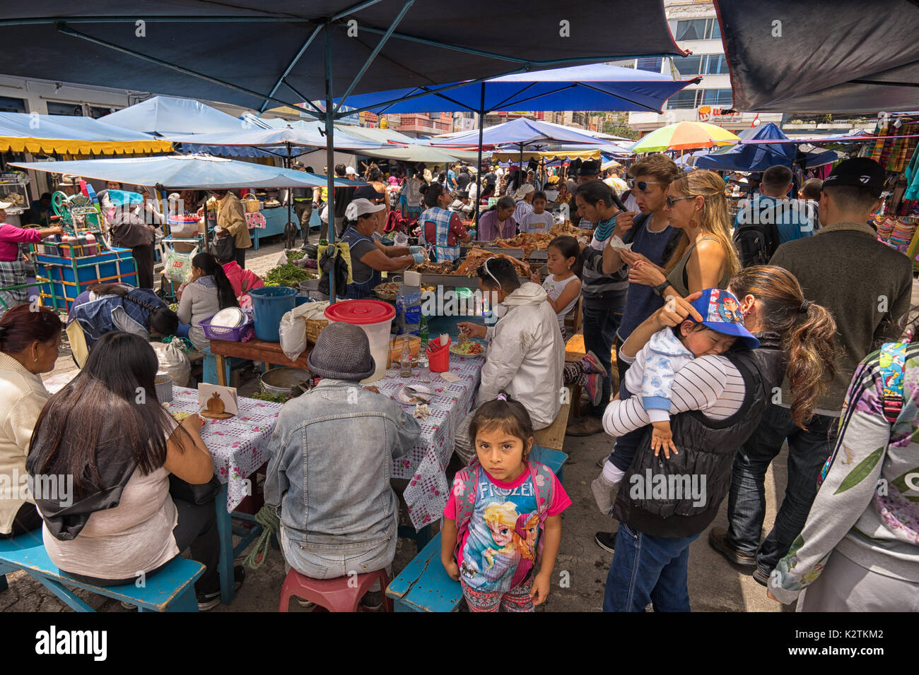 April 29, 2017 Otavalo, Ecuador: makeshift food stands equally popular with locals and tourists on the street in Stock Photo