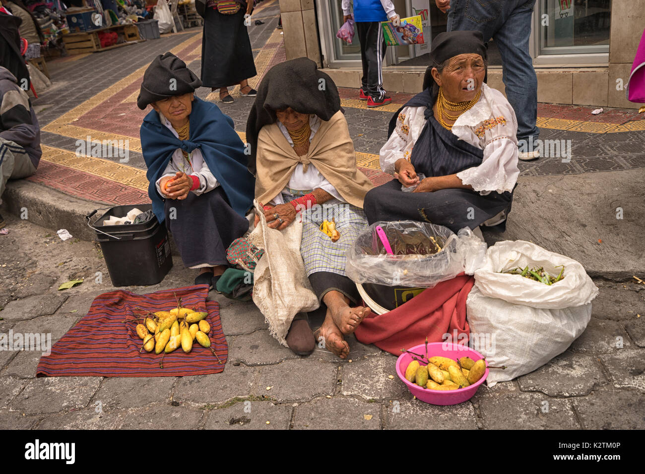 April 29, 2017 Otavalo, Ecuador: indigenous quechua people selling prduce from the ground on the street in the Saturday Stock Photo