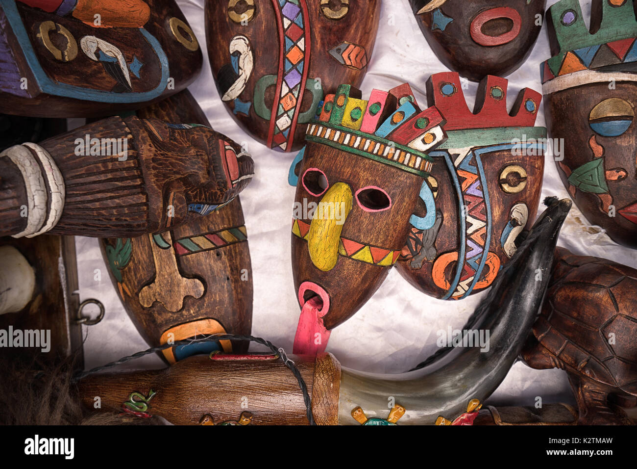 April 29, 2017 Otavalo, Ecuador: indigenous quechua face masks made of wood  selling on the street in the Saturday market - Stock Image