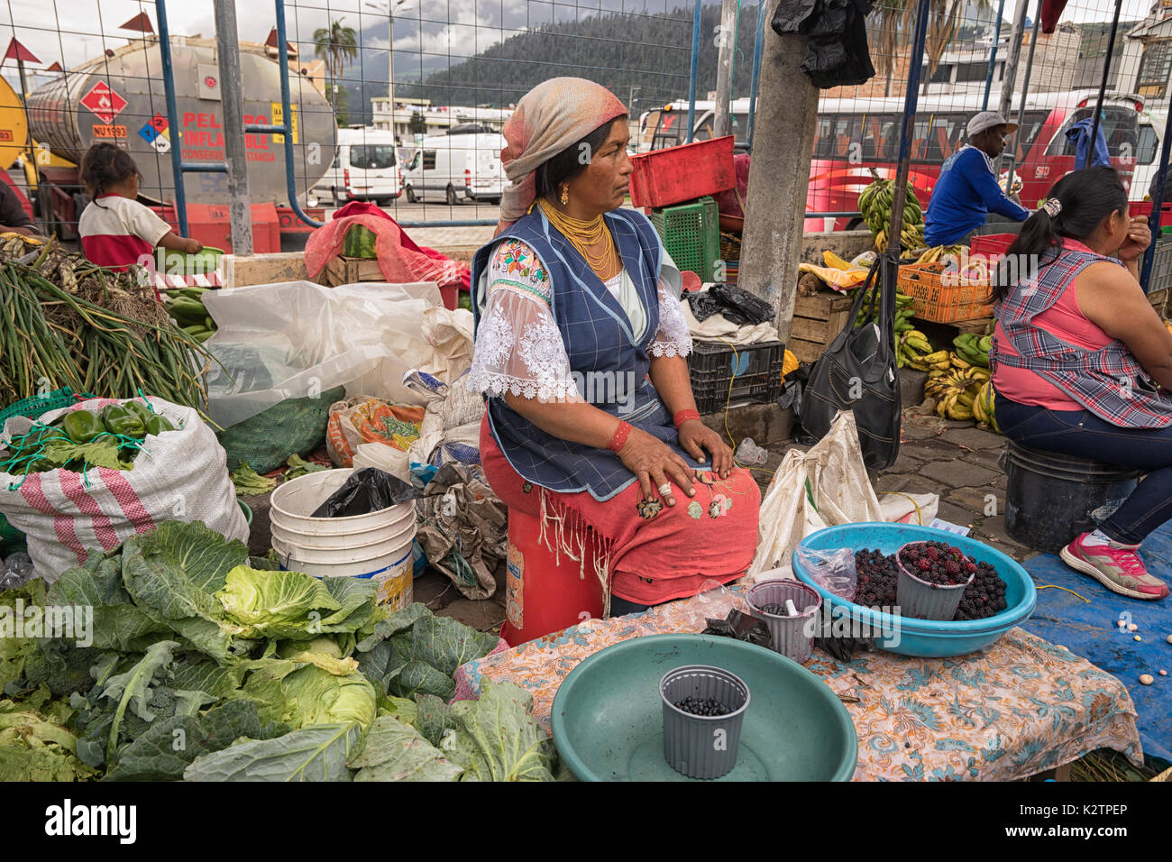 May 6, 2017 Otavalo, Ecuador: produce vendor in the Saturday market selling from street level - Stock Image