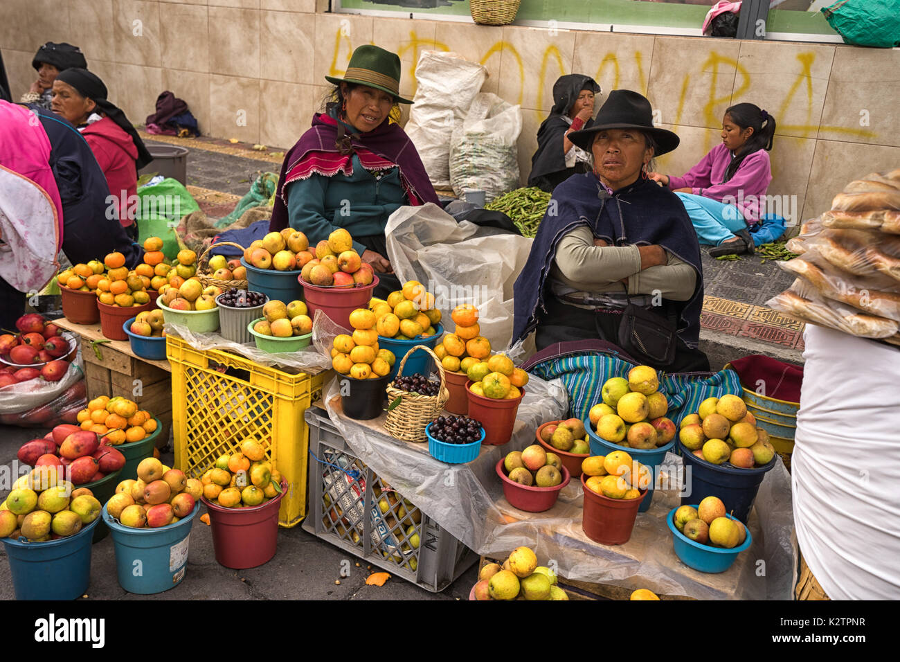 May 6, 2017 Otavalo, Ecuador: indigenous produce vendors in the Saturday market - Stock Image