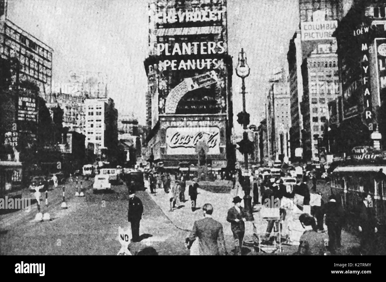 Broadway, New York,USA (from a 1940's magazine) showing neon advertising  and other signs for Chevrolet, Planter's peanuts,Coca Cola, Columbia Pictures and Mayfair - Stock Image
