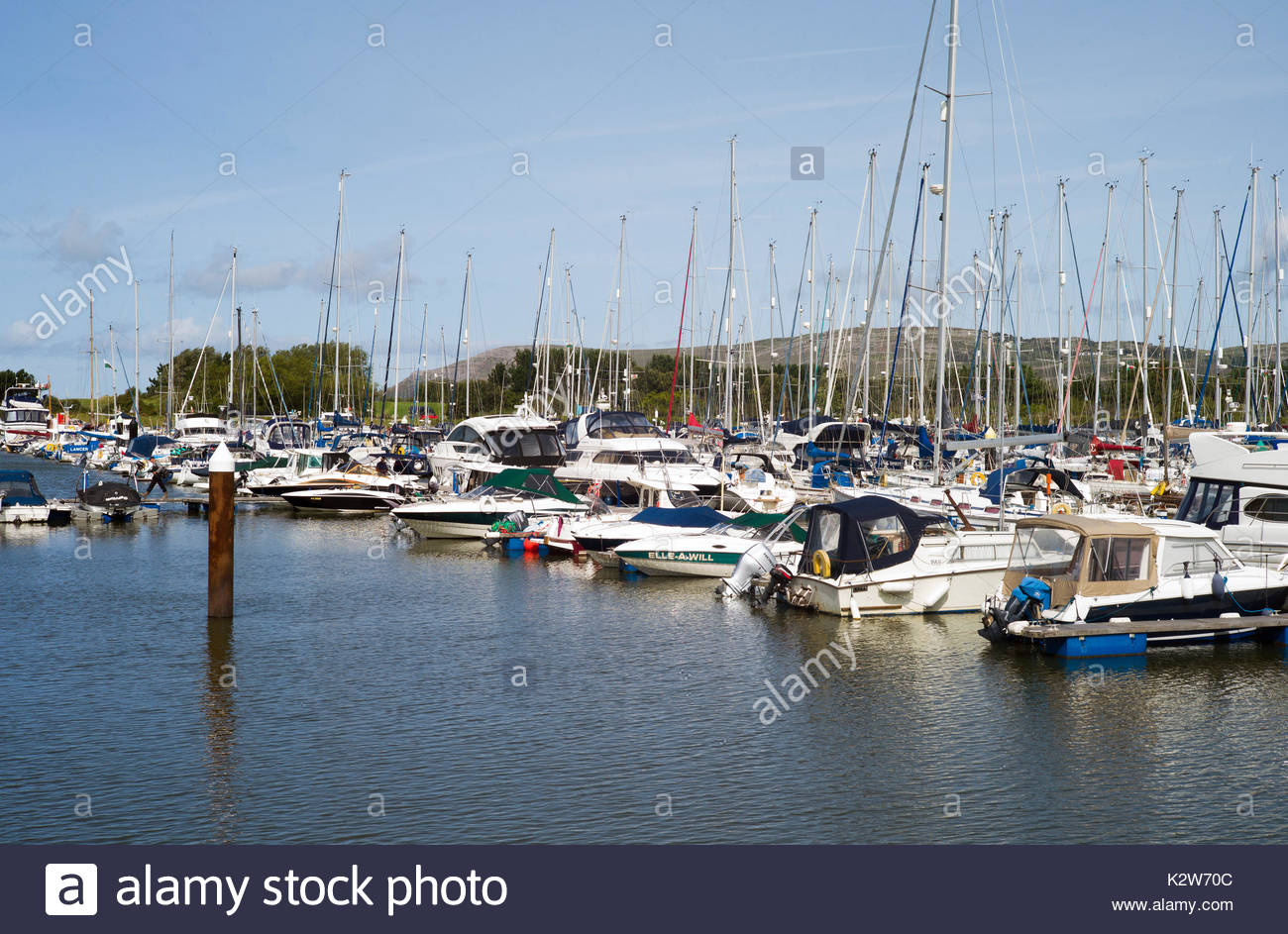 The newly developed marina at Conwy, north Wales, UK, with many sailing yachts and motor cruisers at their moorings. Stock Photo