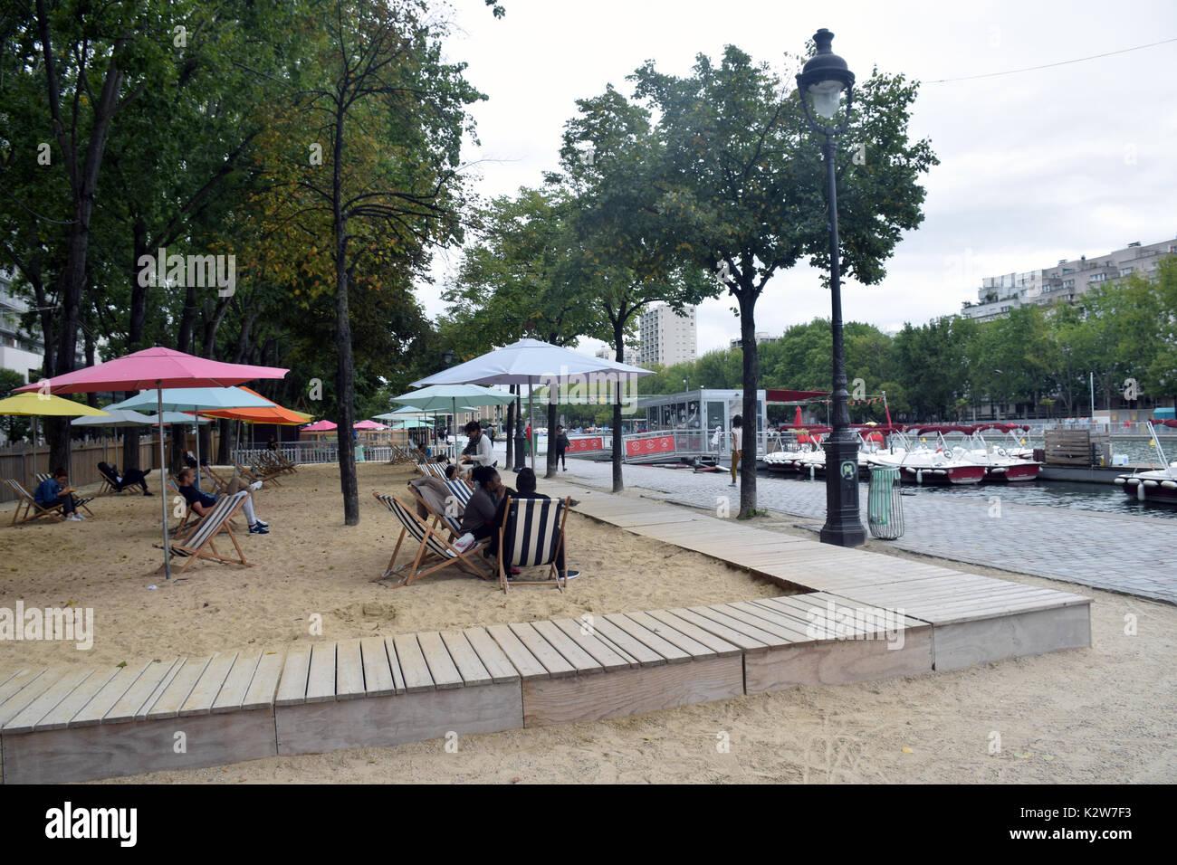 Artificial beach, Quai de la Seine, Bassin de la Villette, Paris, France - Stock Image