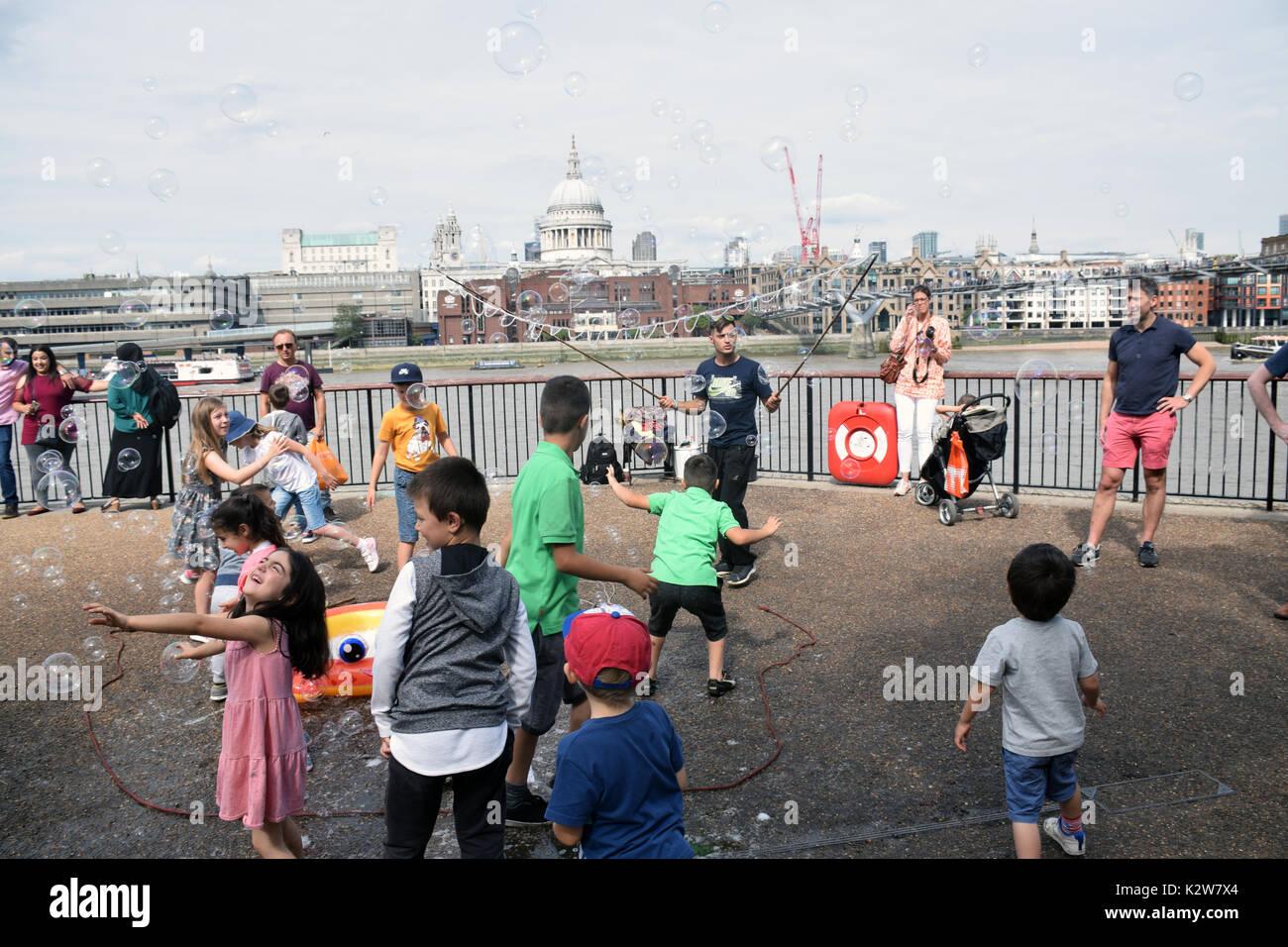 Bubbles entertainer, South Bank, London UK - Stock Image