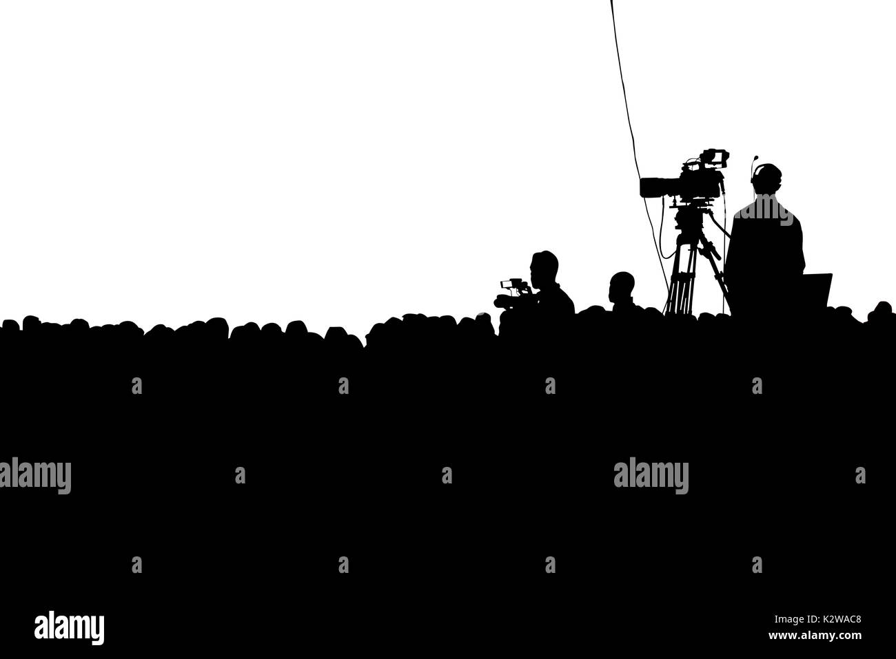Television Press Conference production cameraman and crowd silhouette. Clipping path - Stock Image