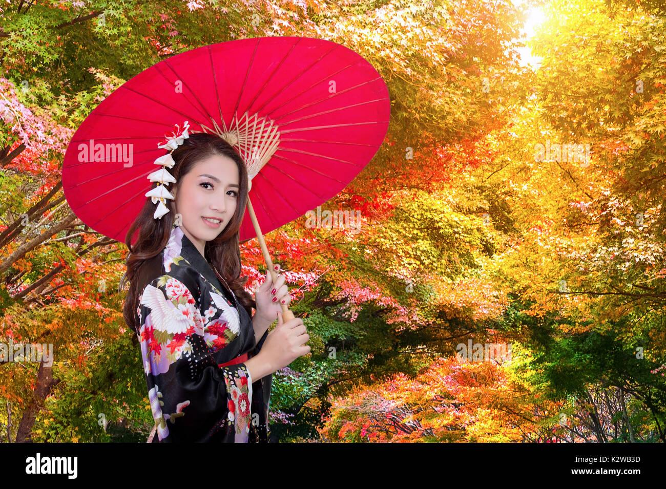 f6754a53ea66b Asian woman wearing kimono in autumn Stock Photo  156680145 - Alamy