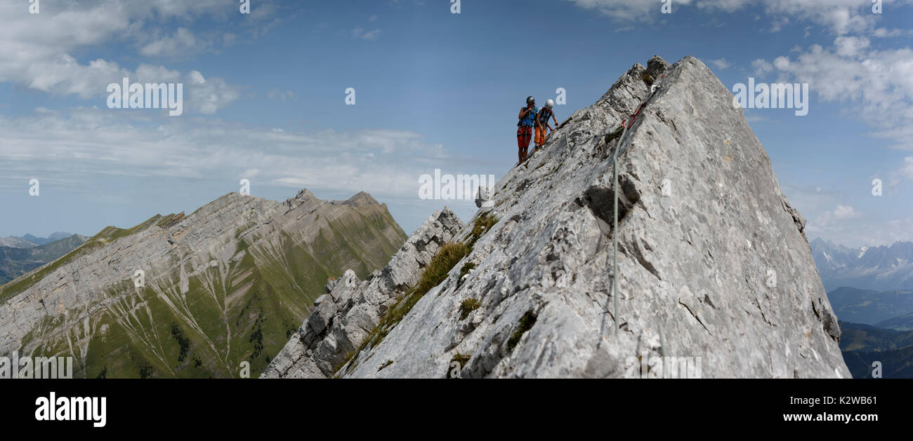 Two people climbing on Arete a Marion in the Aravis mountains, France Stock Photo