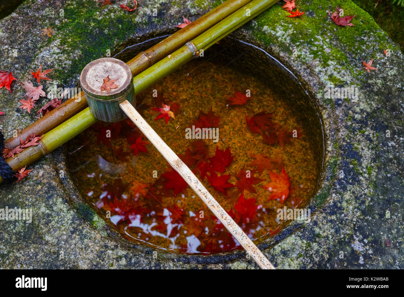Water dipper on a stone basin at Koto-in Temple in Kyoto, Japan   KYOTO, JAPAN - NOVEMBER 23 2015: Koto-in Temple is one of Daitokuji sub temples, fou - Stock Image