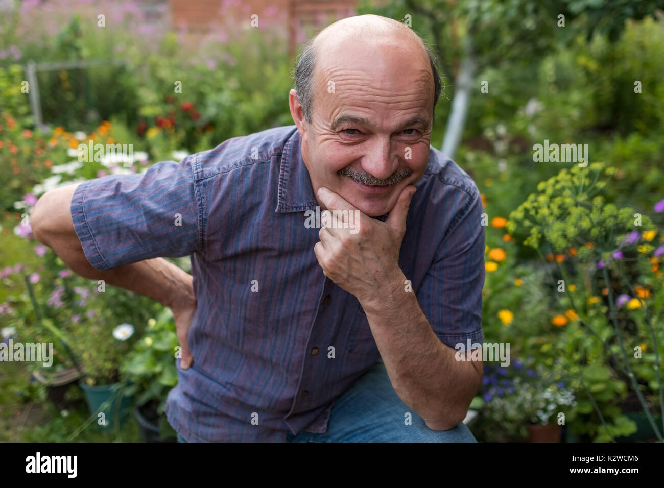 handsome caucasian maturing man with mustache. - Stock Image