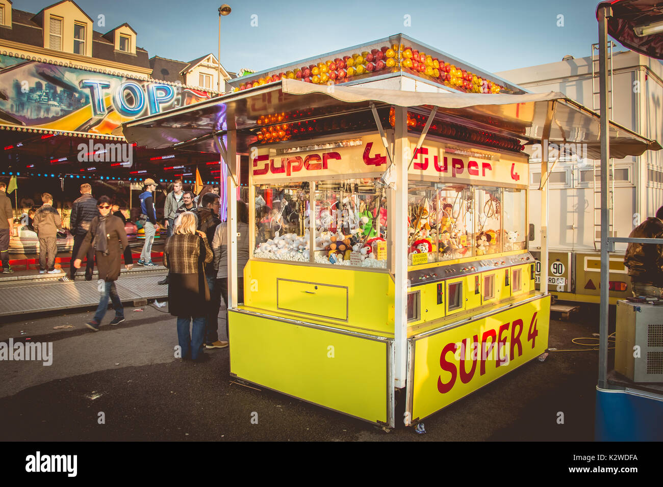 SABLES D OLONNE, FRANCE - November 27, 2016: In a traditional funfair a claw machine allows to win stuffed animals and souvenirs - Stock Image