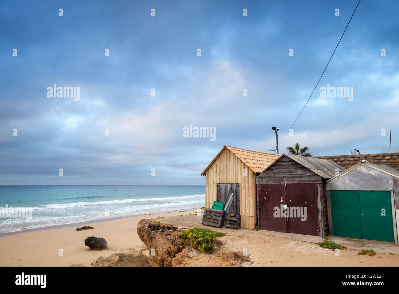 Coastal barns on the beach of Porto Santo island in the Madeira archipelago, Portugal - Stock Image