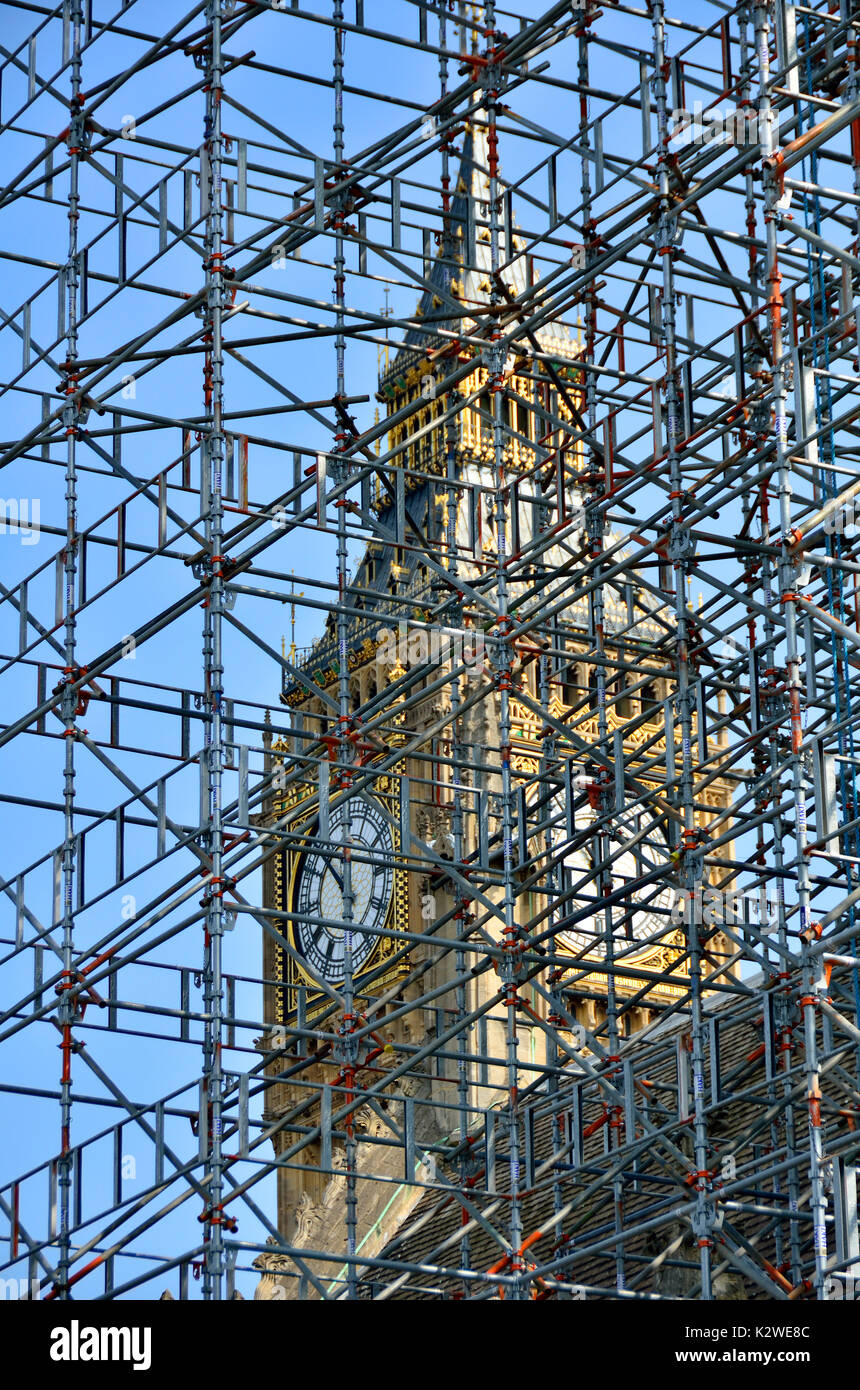 London, England, UK. Big Ben seen through scaffolding during renovation work at the Houses of Parliament (2017) - Stock Image