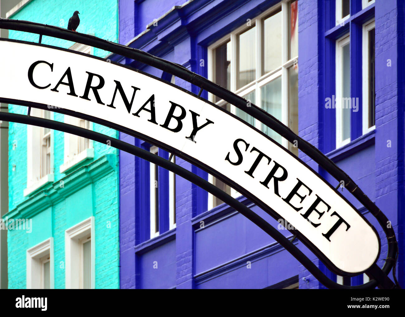 London, England, UK. Carnaby Street sign, with pigeon - Stock Image