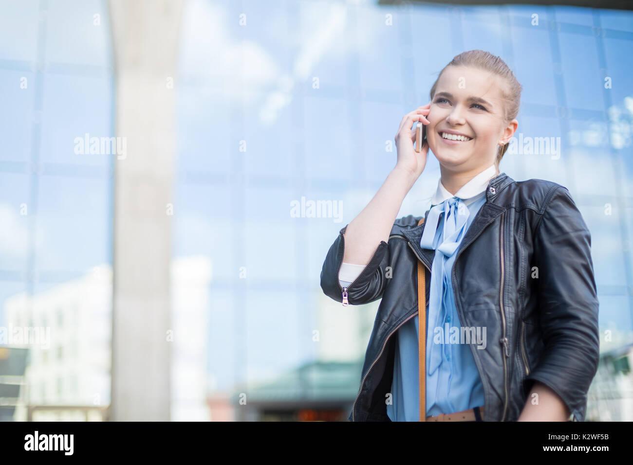 Cheerful woman having nice phone call - Stock Image