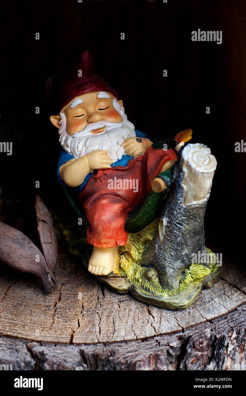 Snoozing gnome, Switzerland. - Stock Image