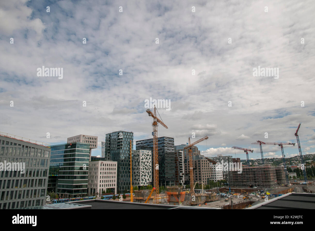 Construction work going on around the Barcode development in Bjørvika, central Oslo, as seen from the Oslo Opera House. - Stock Image