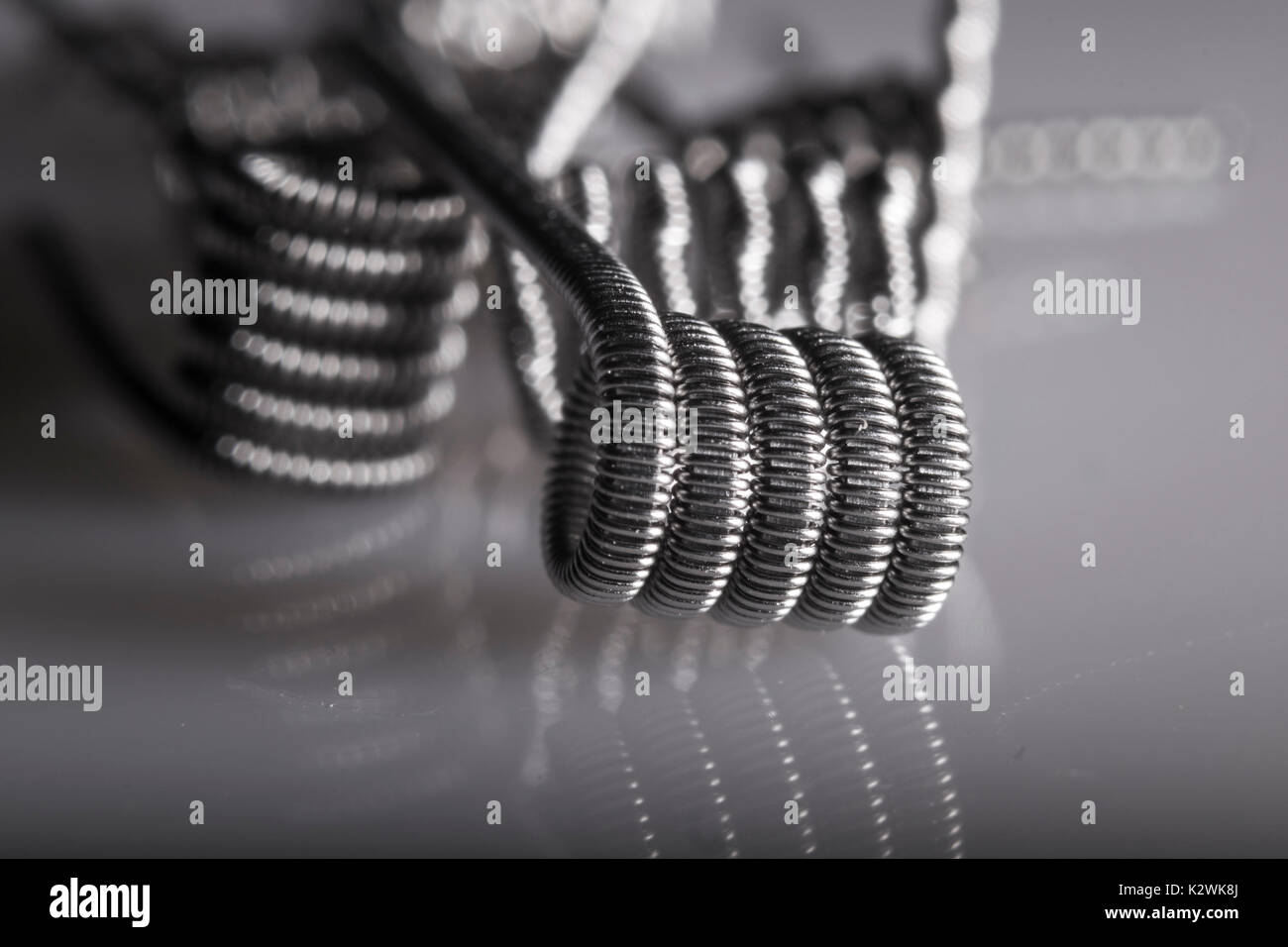 Alien Clapton coils example for vaping with electronic cigarette, e cig, ecigarette. - Stock Image
