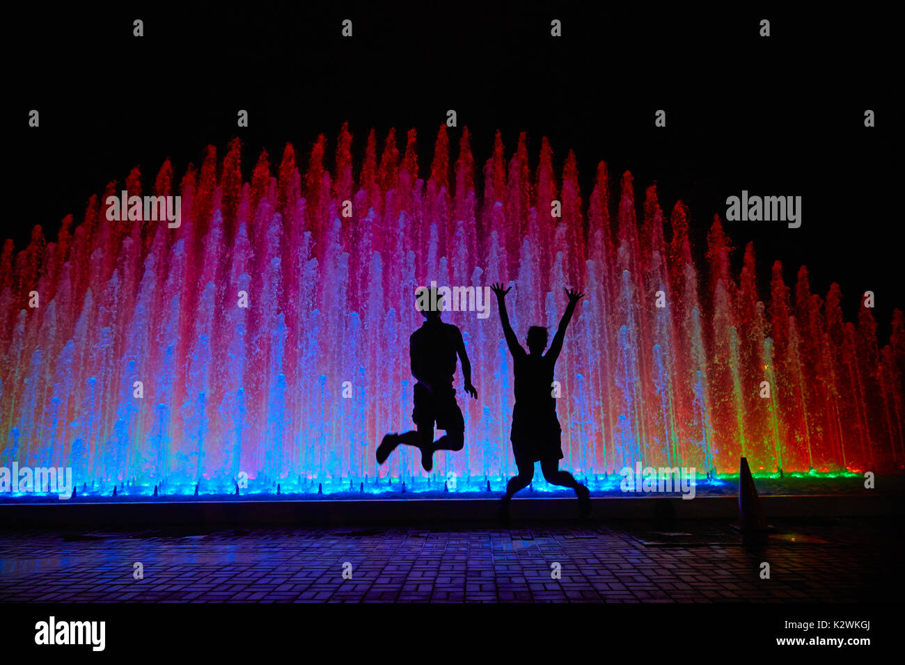 Tourists at Rainbow Fountain at the Magic Water Circuit (world's largest fountain complex), Park of the Reserve, Stock Photo