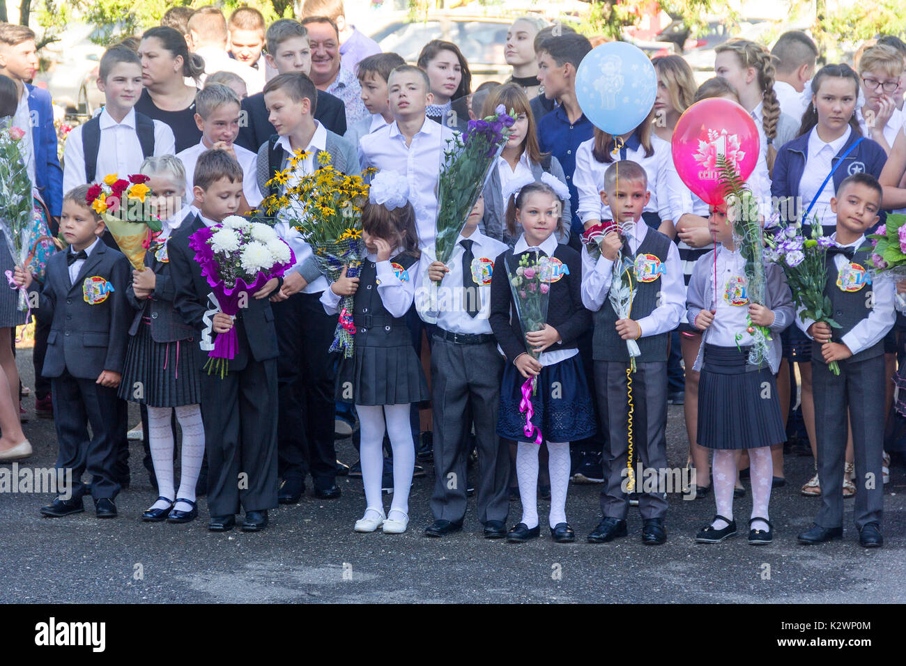Adygea, Russia - September 1, 2017: Children enrolled in the first grade at school with teachers and parents at the inauguration of the school year in - Stock Image