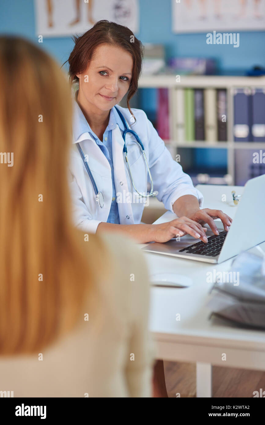 Tell me more about your ailment - Stock Image