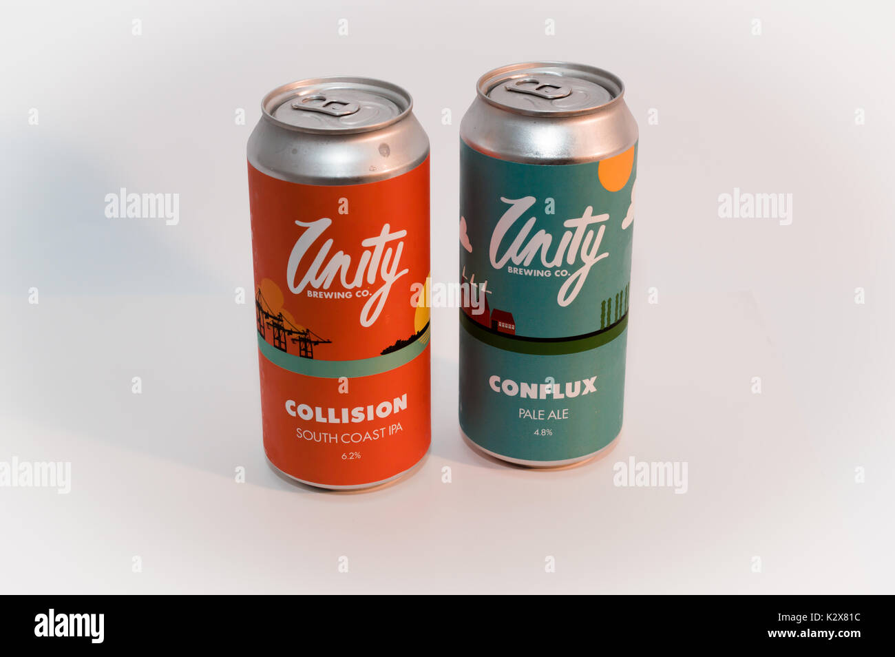 Two cans of Unity craft ale on white background - Stock Image