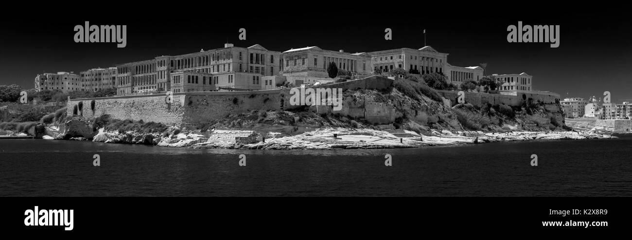 Black and White view of Conference Centre Villa Bighi, Triq Marina, Il-Kalkara, Malta - viewed from Grand Harbour, Valetta, Malta - Stock Image