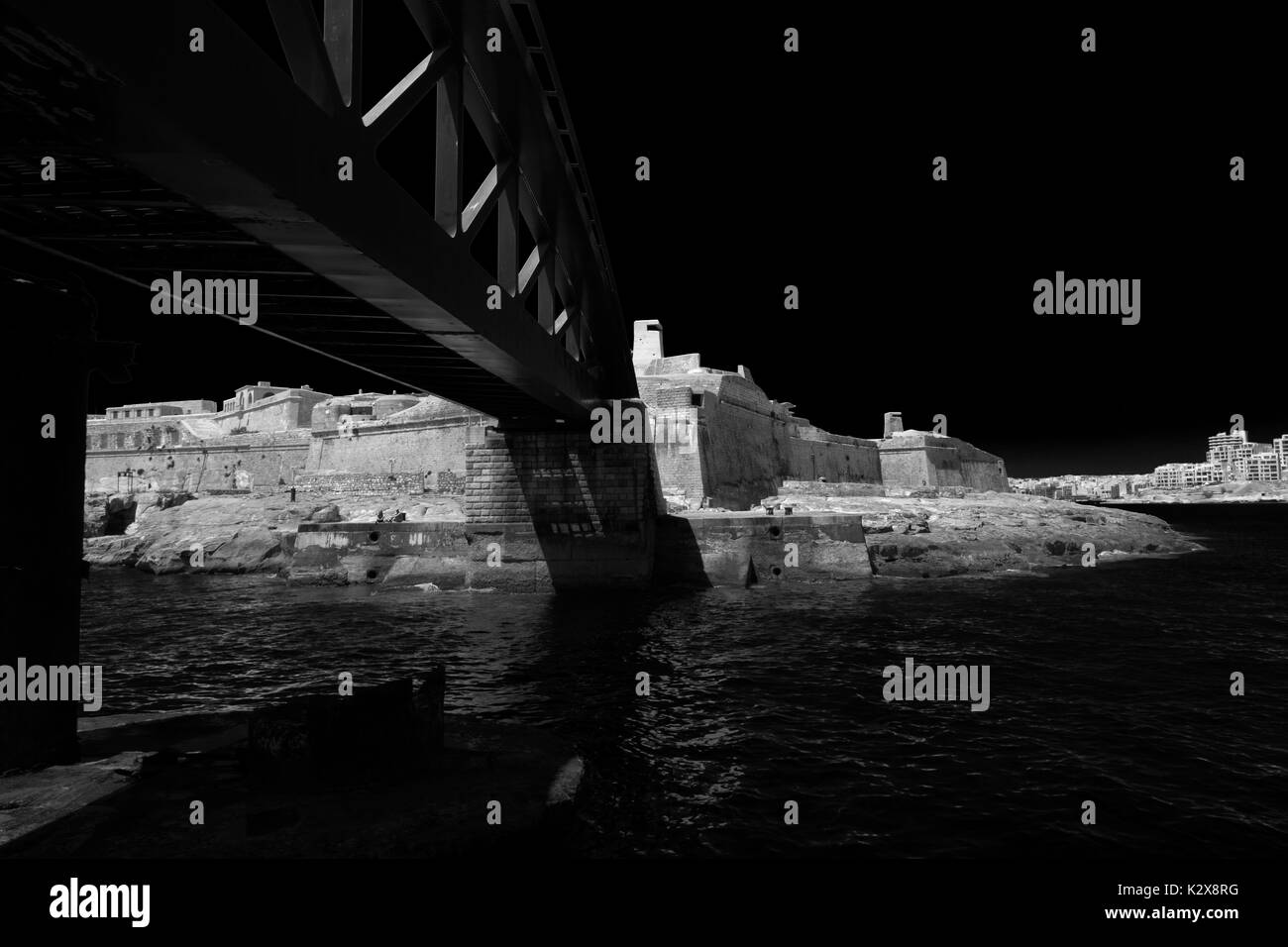 Black and White view of Fort St Elmo, Valletta, Malta, from the entrance of Grand Harbour. - Stock Image