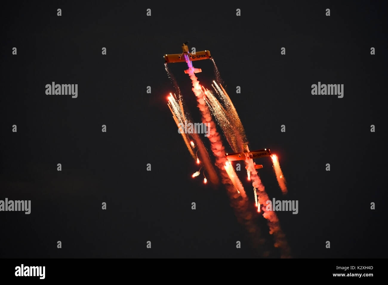Fireflies aerobatic display team flying their pyrotechnics show at the Clacton airshow. Space for copy - Stock Image