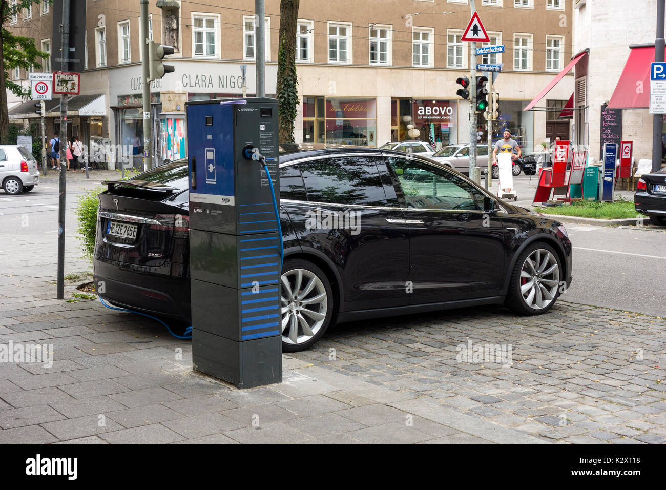 Tesla Electic Car at Charging Station, Munich, Germany - Stock Image
