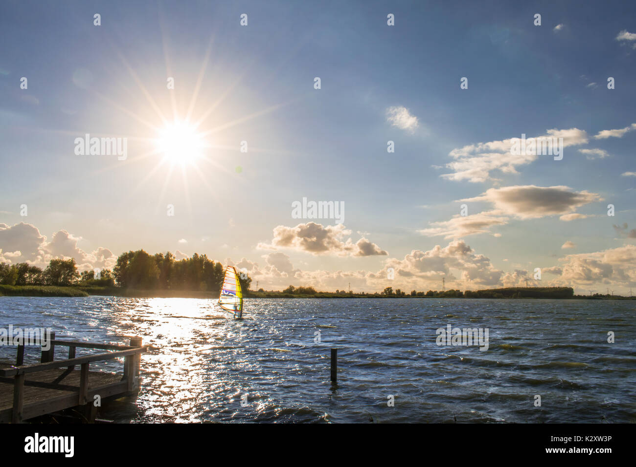 Watersport surfing lake in sunset - Stock Image