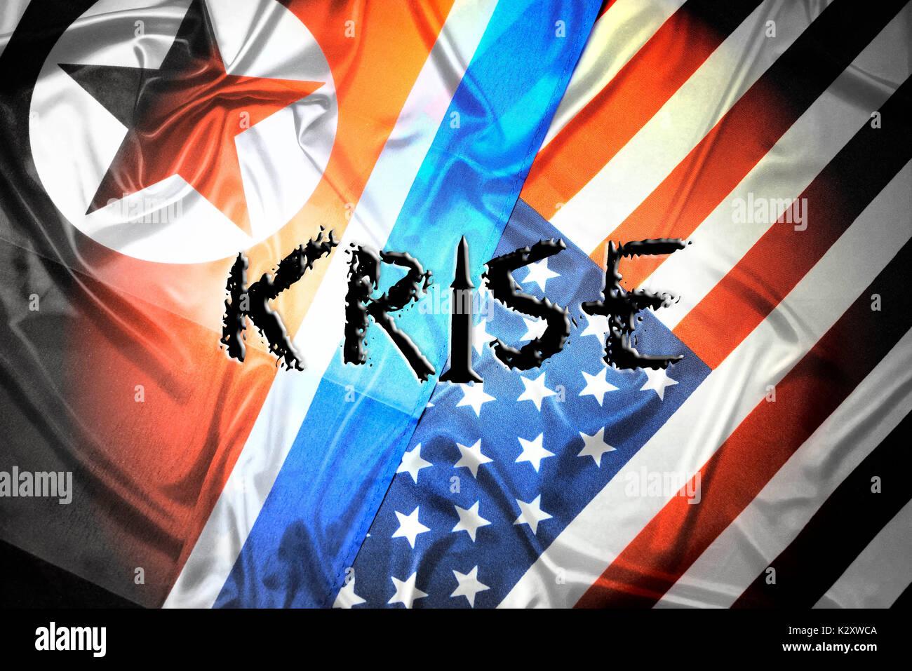 Flags of the USA and North Korea with the stroke crisis, Fahnen von den USA und Nordkorea mit dem Schriftzug Krise - Stock Image