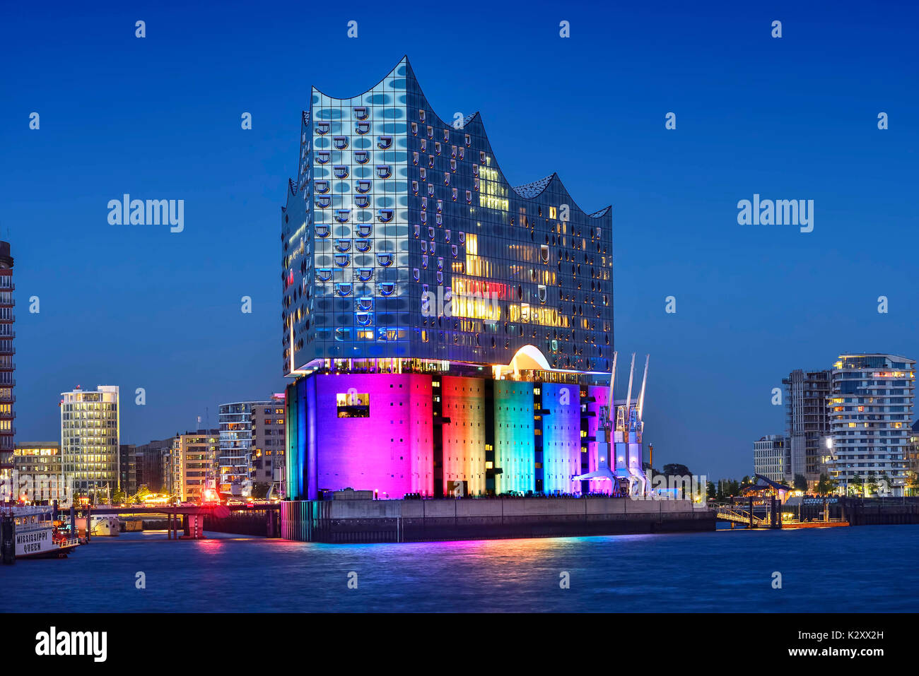 The Elbphilharmonie illuminates in rainbow colours to Christopher Street Day in Hamburg, Germany, Europe, Die Elbphilharmonie illuminiert in Regenboge - Stock Image