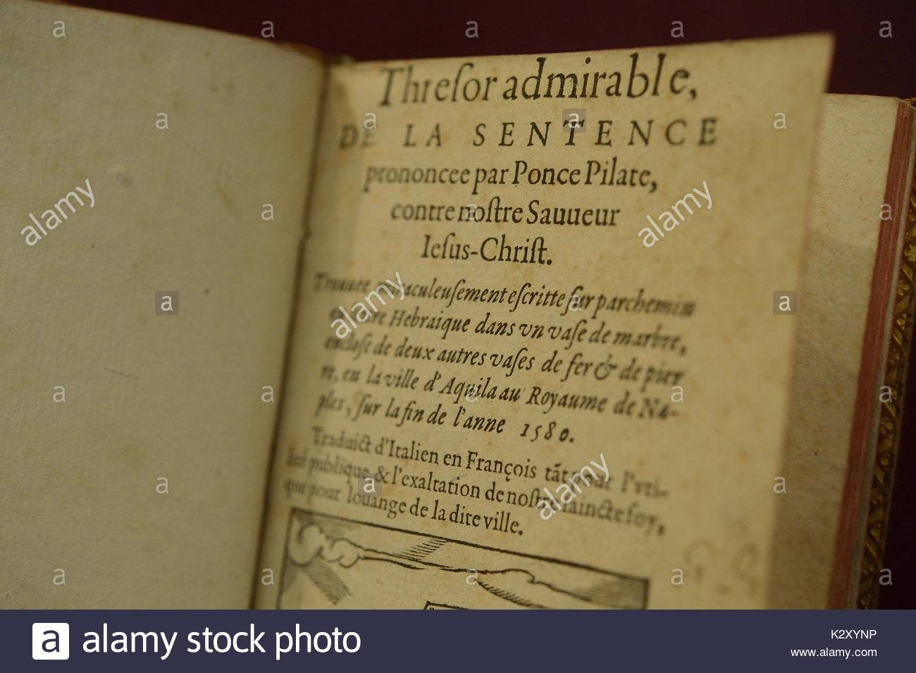 Up close image of page from an old text describing the death sentence of Jesus Christ by Pontius Pilate, dated 1580, part of an exhibition by the Johns Hopkins University and the Maryland College Institute of Art discussing rare books and conservation methods, Baltimore, Maryland, 2015. - Stock Image