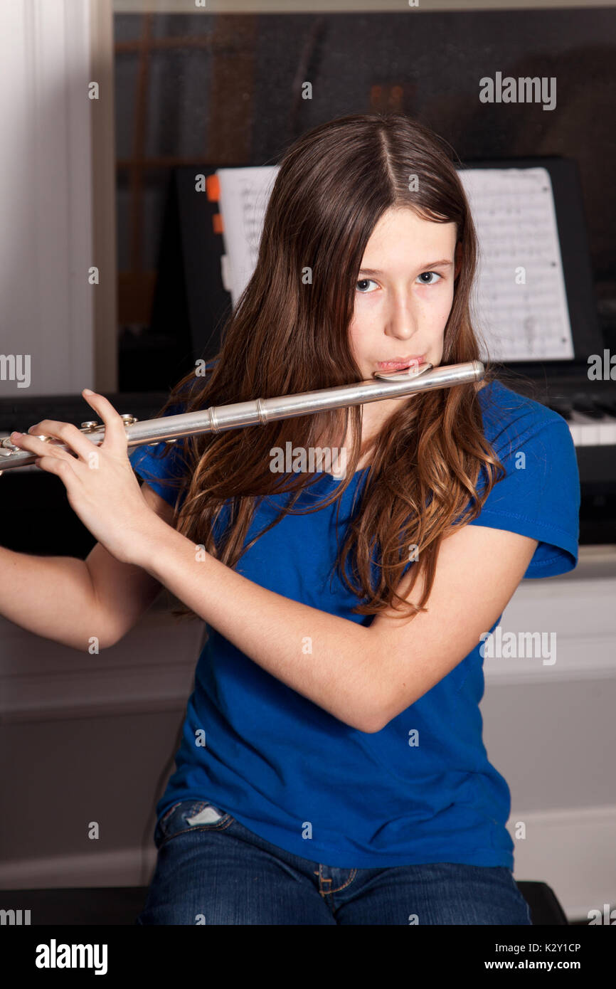 young musician practices the flute Stock Photo